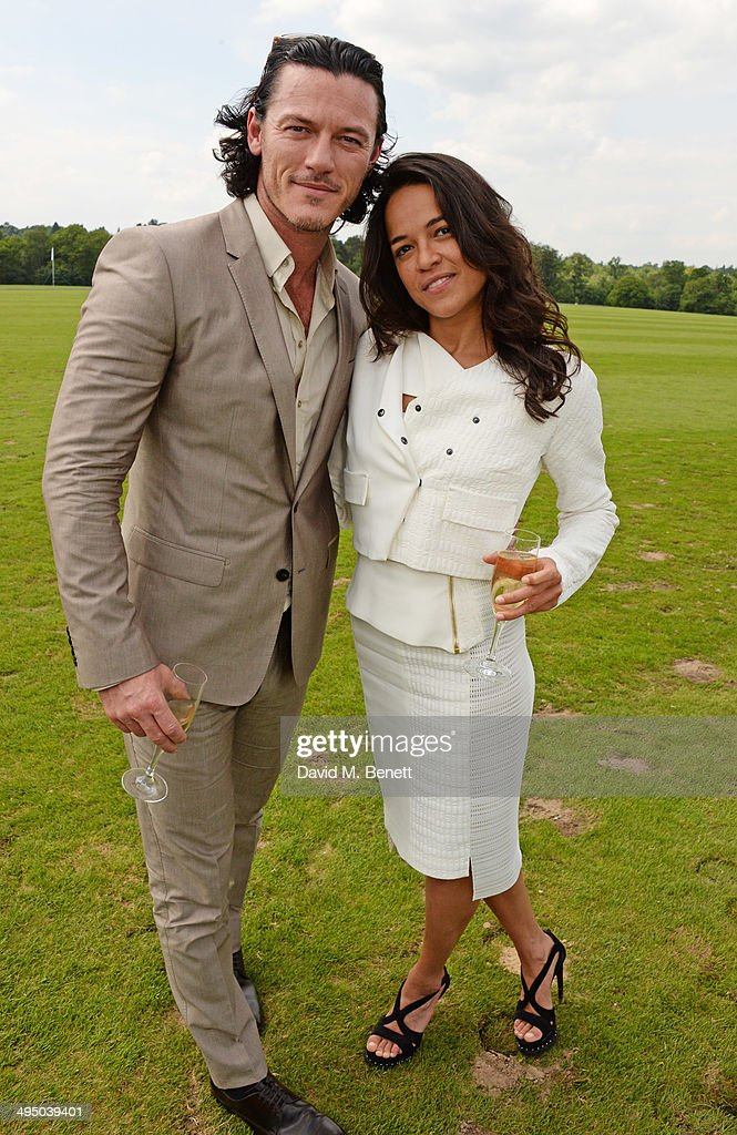 Luke Evans (L) and Michelle Rodriguez attend day two of the Audi Polo Challenge at Coworth Park Polo Club on June 1, 2014 in Ascot, England.