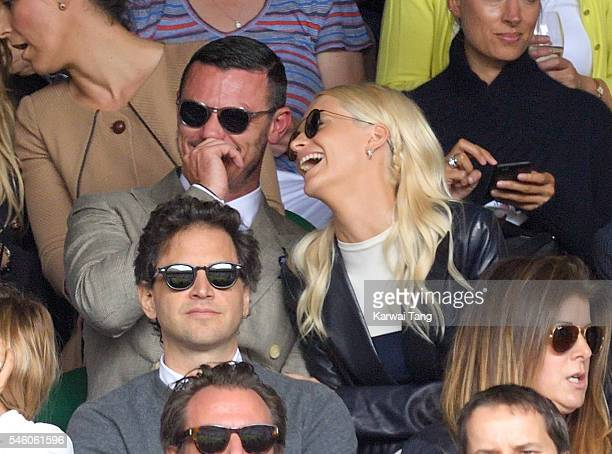Luke Evans and Poppy Delevingne attend the Men's Final of the Wimbledon Tennis Championships between Milos Raonic and Andy Murray at Wimbledon on...