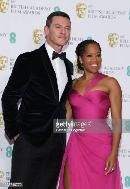 Luke Evans and Regina King pose in the press room during the EE British Academy Film Awards at Royal Albert Hall on February 10 2019 in London England