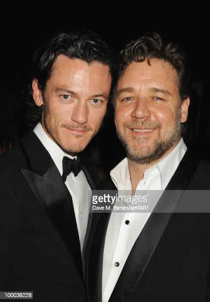 Luke Evans and Russell Crowe attend amfAR's Cinema Against AIDS 2010 benefit gala dinner at the Hotel du Cap on May 20, 2010 in Antibes, France.