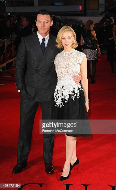 Luke Evans and Sarah Gadon attend the UK Premiere of Dracula Untold at Odeon West End on October 1 2014 in London England
