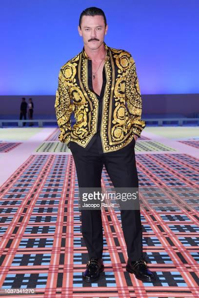 Luke Evans arrives at the Versace show during Milan Fashion Week Spring/Summer 2019 on September 21 2018 in Milan Italy