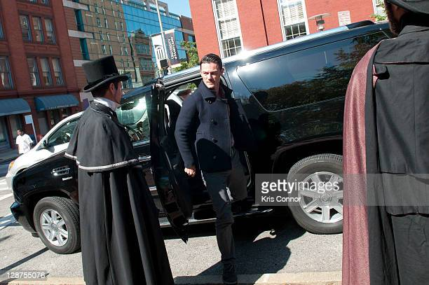 Luke Evans arrives before laying a wreath with Director James McTeigue at the grave of Edgar Allan Poe on the 162nd anniversary of his death at...