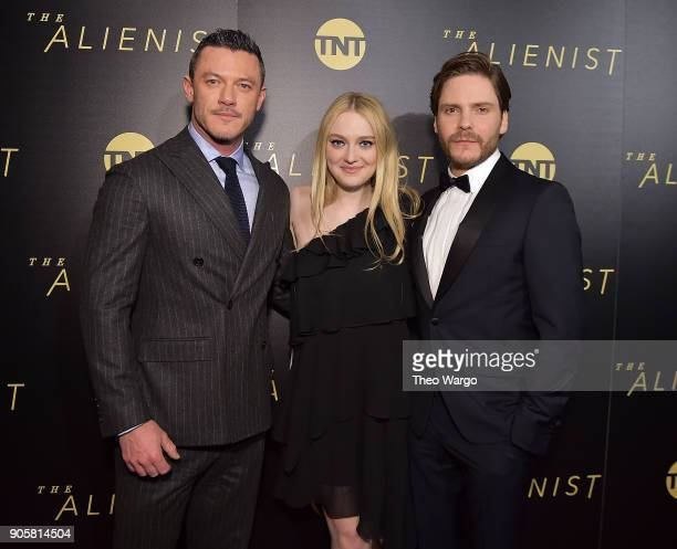 Luke Evans Dakota Fanning and Daniel Brhl attend the New York Premiere Of TNT's 'The Alienist' Arrivals at iPic Cinema on January 16 2018 in New York...
