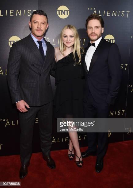 Luke Evans Dakota Fanning and Daniel Brühl attend the premiere of TNT's 'The Alienist' at iPic Cinema on January 16 2018 in New York City