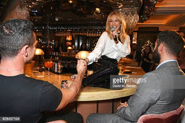 Luke Evans Kylie Minogue and Joshua Sasse attend an intimate performance with Kylie Minogue at The Ivy to kick off The Ivy 100 Centenary celebrations...
