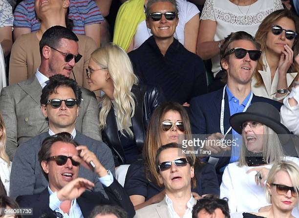 Luke Evans Poppy Delevingne and James Cook attend the Men's Final of the Wimbledon Tennis Championships between Milos Raonic and Andy Murray at...