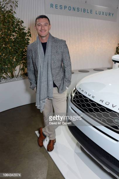 Luke Evans poses alongside the new Range Rover Evoque during its World Premiere at The Old Truman Brewery on November 22 2018 in London England