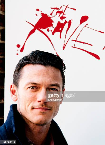 Luke Evans poses for a photo after laying a wreath on the grave of Edgar Allan Poe on the 162nd anniversary of his death at Westminster Hall on...