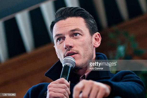 Luke Evans speaks during a Q&A discussion before laying a wreath on the grave of Edgar Allan Poe on the 162nd anniversary of his death at Westminster...