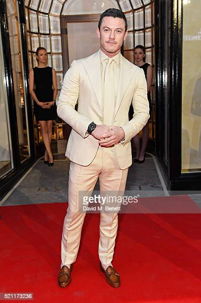 Luke Evans wearing a Bulgari watch arrives at the Bulgari flagship store reopening on New Bond Street on April 14 2016 in London England