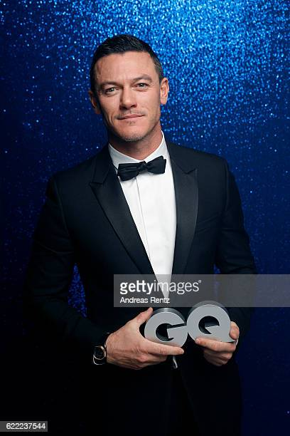 Luke Evans wearing a Bulgari watch poses backstage at the GQ Men of the year Award 2016 at Komische Oper on November 10 2016 in Berlin Germany