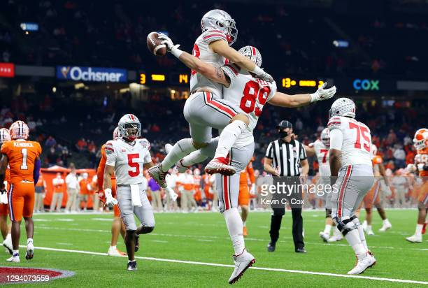 Luke Farrell and Jeremy Ruckert of the Ohio State Buckeyes celebrate a touchdown against the Clemson Tigers in the first quarter during the College...