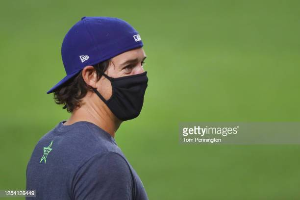 Luke Farrell of the Texas Rangers wears a face mask during Major League Baseball Summer Workouts at Globe Life Field on July 03, 2020 in Arlington,...