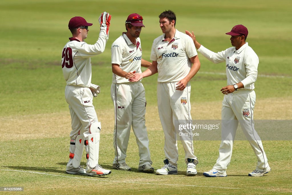 Luke Feldman of Queensland celebrates dismissing David Warner of New South Wales during day three of the Sheffield Shield match between Queensland and New South Wales at Allan Border Field on November 15, 2017 in Brisbane, Australia.