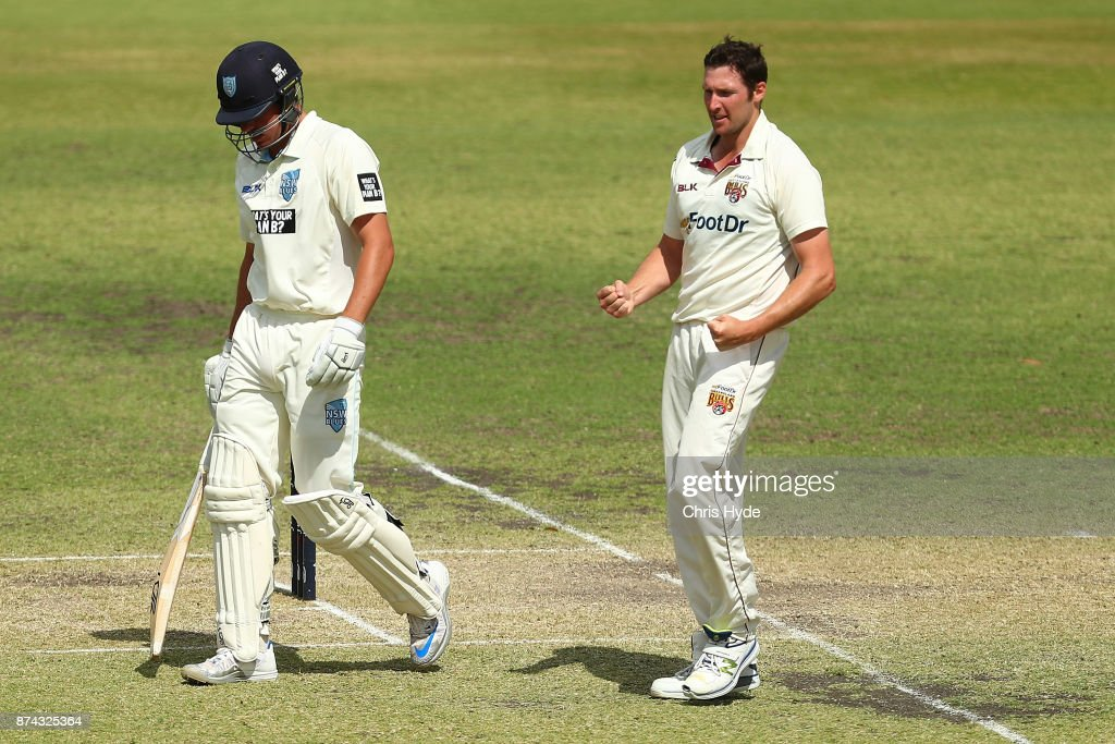 Luke Feldman of Queensland celebrates dismissing Moises Henriques of New South Wales during day three of the Sheffield Shield match between Queensland and New South Wales at Allan Border Field on November 15, 2017 in Brisbane, Australia.