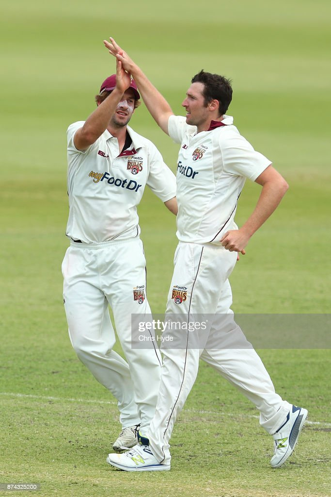Luke Feldman of Queensland celebrates dismissing Nic Maddinson of New South Wales during day three of the Sheffield Shield match between Queensland and New South Wales at Allan Border Field on November 15, 2017 in Brisbane, Australia.