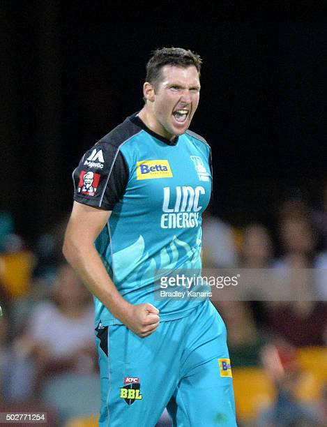 Luke Feldman of the Heat celebrates after taking the wicket of Kumar Sangakkara of the Hurricanes during the Big Bash League match between the...
