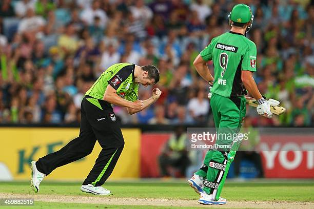 Luke Feldman of the Thunder celebrates after claiming the wicket of Cameron White of the Stars during the Big Bash League match between Sydney...