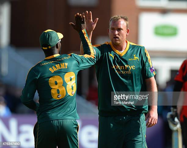 Luke Fletcher of Nottingham Outlaws celebrates with Darren Sammy of Nottingham Outlaws after taking a wicket during the NatWest T20 Blast between...