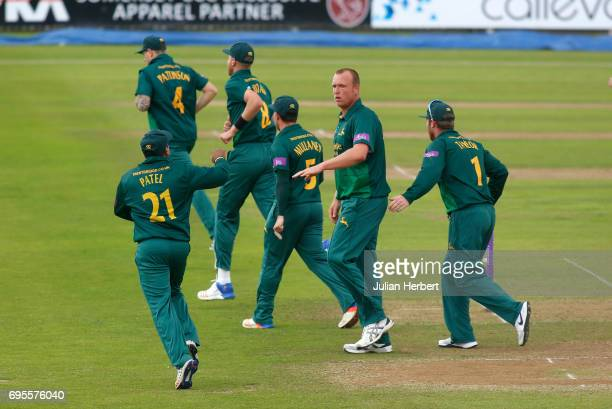Luke Fletcher of Nottinghamshire Outlaws is congratulated by team mates after taking the wicket of Steve Davies of Somerset during The Royal London...