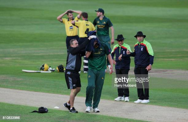 Luke Fletcher of Notts Outlaws is helped off the field after being hit by the ball during the Natwest T20 Blast match between Birmingham Bears and...