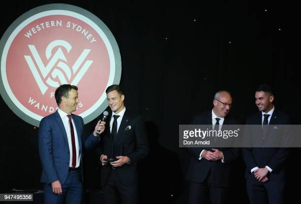 Luke Foley looks on as Oriol Riera accepts his awards for ALeague Player of the Year Media Award and Golden Boot during the Wanderers Medal 2018 on...