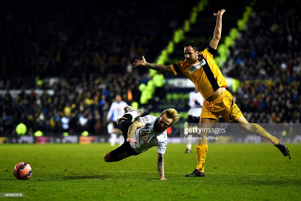 Luke Foster of Southport fouls Johnny Russell of Derby and concedes a penalty during the FA Cup Third Round match between Derby County and Southport FC at iPro Stadium on January 3, 2015 in Derby, England.
