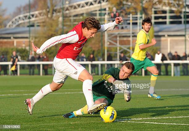 Luke Freeman of Arsenal takes the ball round Declan Rudd of Norwich during the Arsenal Reserves v Norwich City Reserves match at London Colney on...