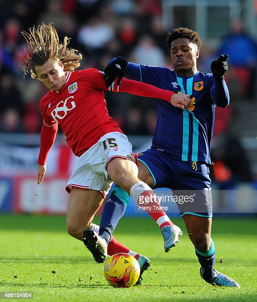 Luke Freeman of Bristol City is tackled by Chuba Akpom of Hull City during the Sky Bet Championship match between Bristol City and Hull City at...