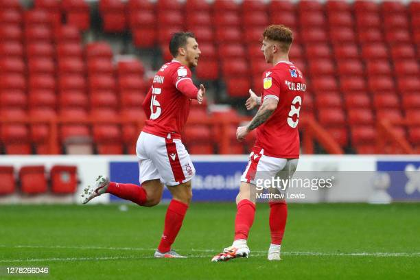 Luke Freeman of Nottingham Forest celebrates with teammate Jack Colback after scoring his team's first goal during the Sky Bet Championship match...