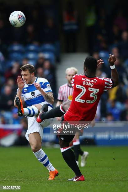 Luke Freeman of QPR and Lamine Kone of Sunderland in action during the Sky Bet Championship match between QPR and Sunderland at Loftus Road on March...