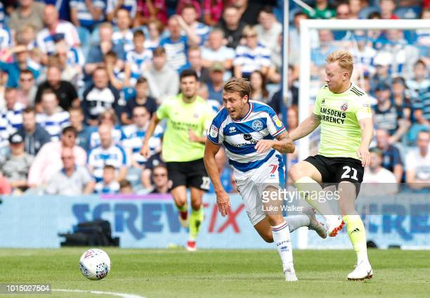 Luke Freeman of Queens Park Rangers and Mark Duffy of Sheffield United during the Sky Bet Championship match between Queens Park Rangers and...