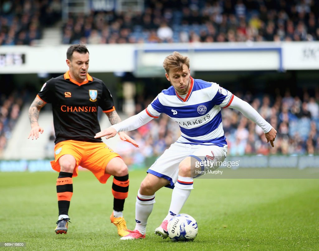 Luke Freeman of Queens Park Rangers is closed down by Ross Wallace of Sheffield Wednesday during the Sky Bet Championship match between Queens Park Rangers and Sheffield Wednesday at Loftus Road on April 17, 2017 in London, England.