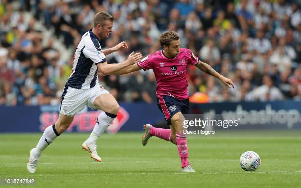 Luke Freeman of Queens Park Rangers moves away from Chris Brunt during the Sky Bet Championship match between West Bromwich Albion and Queens Park...