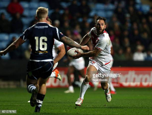 Luke Gale of England challenged by Callum Phillips and Dale Ferguson of Scotland during the Four Nations match between the England and Scotland at...