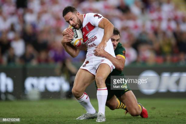 Luke Gale of England is tackled by Cameron Smith of the Kangaroos during the 2017 Rugby League World Cup Final between the Australian Kangaroos and...