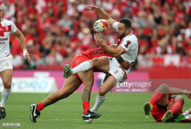 Luke Gale of England looses the ball in a tackle during the Rugby League World Cup men's semifinal match between Tonga and England at Mt Smart...