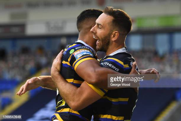 Luke Gale of Leeds Rhinos celebrates with his team mate after scoring a try during the Betfred Super League match between Leeds Rhinos and Salford...