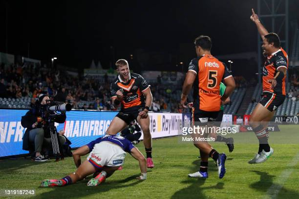 Luke Garner of the Tigers celebrates after scoring a try during the round 11 NRL match between the New Zealand Warriors and the Wests Tigers at...