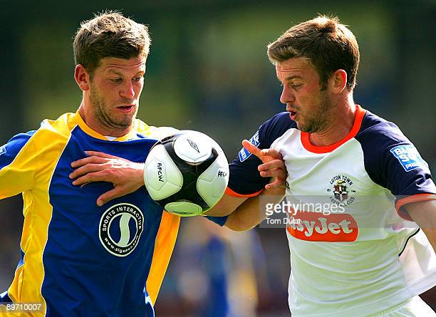 Luke Garrard of AFC Wimbledon battles for the ball with Tom Craddock of Luton Town during the Blue Square Premier League Conference match between AFC...