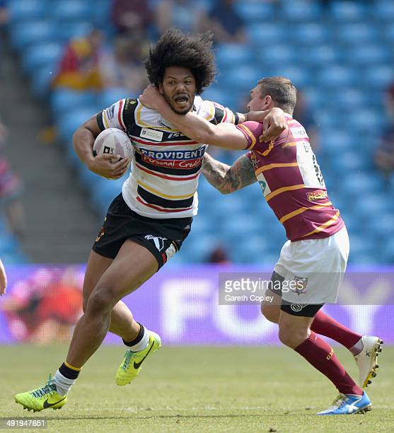 Luke George of Bradford Bulls is tackled by Danny Brough of Huddersfield Giants during the Super League match between Huddersfield Giants and...