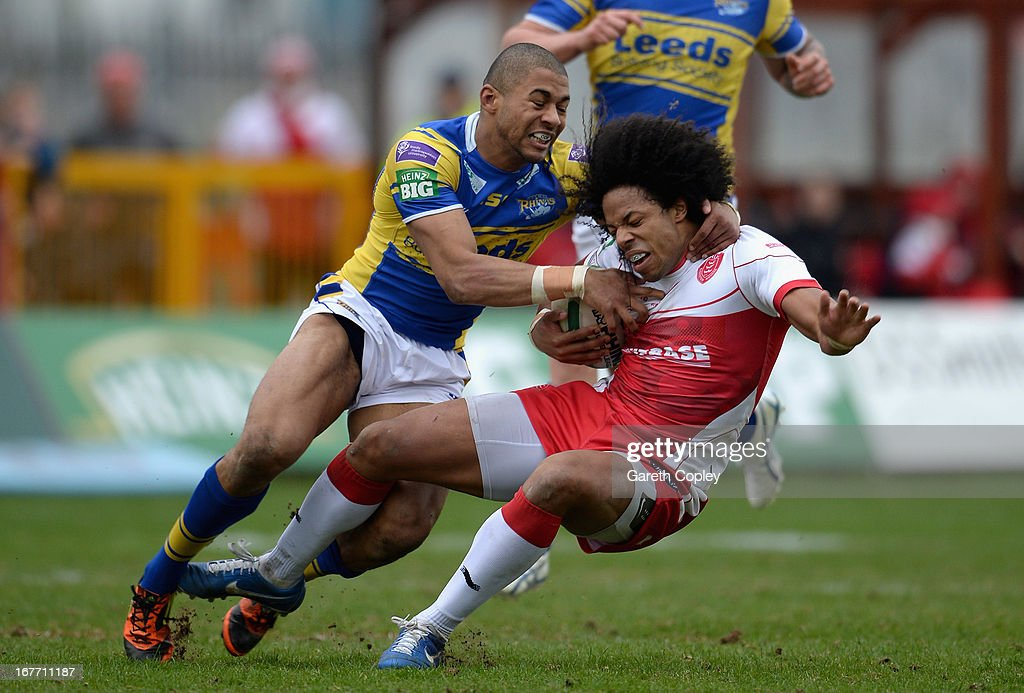 Luke George of Hull KR is tacked by Kallum Watkins of Leeds during the Super League match between Hull Kingston Rovers and Leeds Rhinos at Craven Park Stadium on April 28, 2013 in Hull, England.