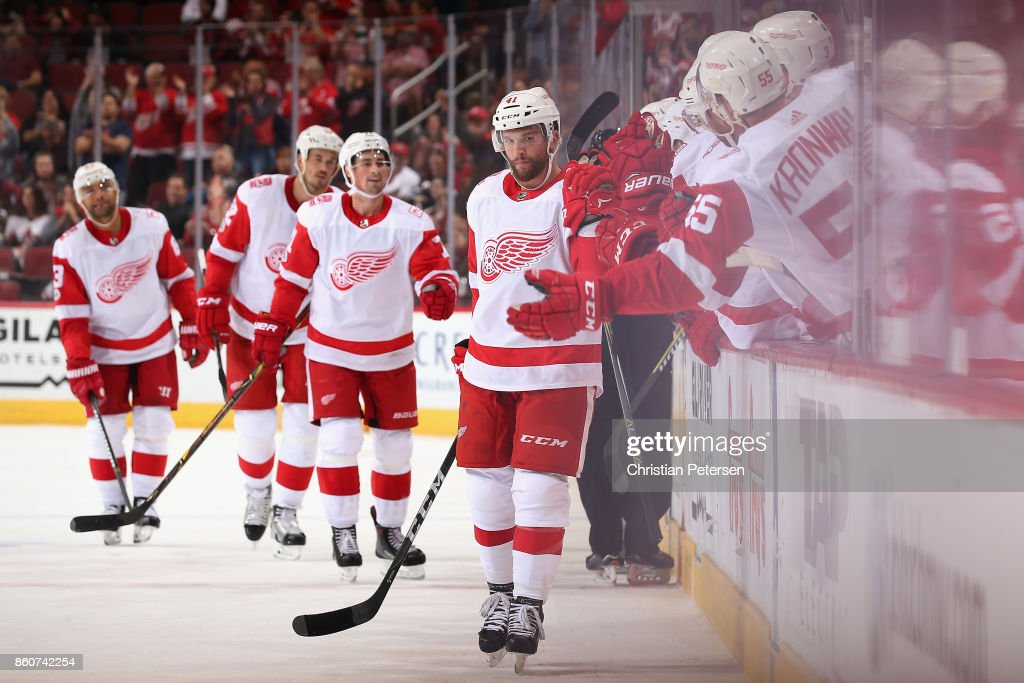 Luke Glendening #41 of the Detroit Red Wings celebrates with teammates on the bench after scoring a shorthanded goal against the Arizona Coyotes during the third period of the NHL game at Gila River Arena on October 12, 2017 in Glendale, Arizona. The Red Wings defeated the Coyotes 4-2.