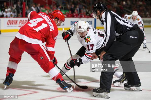 Luke Glendening of the Detroit Red Wings faces off against Dylan Strome of the Chicago Blackhawks during a pre-season NHL game at Little Caesars...