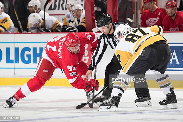 Luke Glendening of the Detroit Red Wings faces off against Sidney Crosby of the Pittsburgh Penguins during an NHL game at Joe Louis Arena on January...