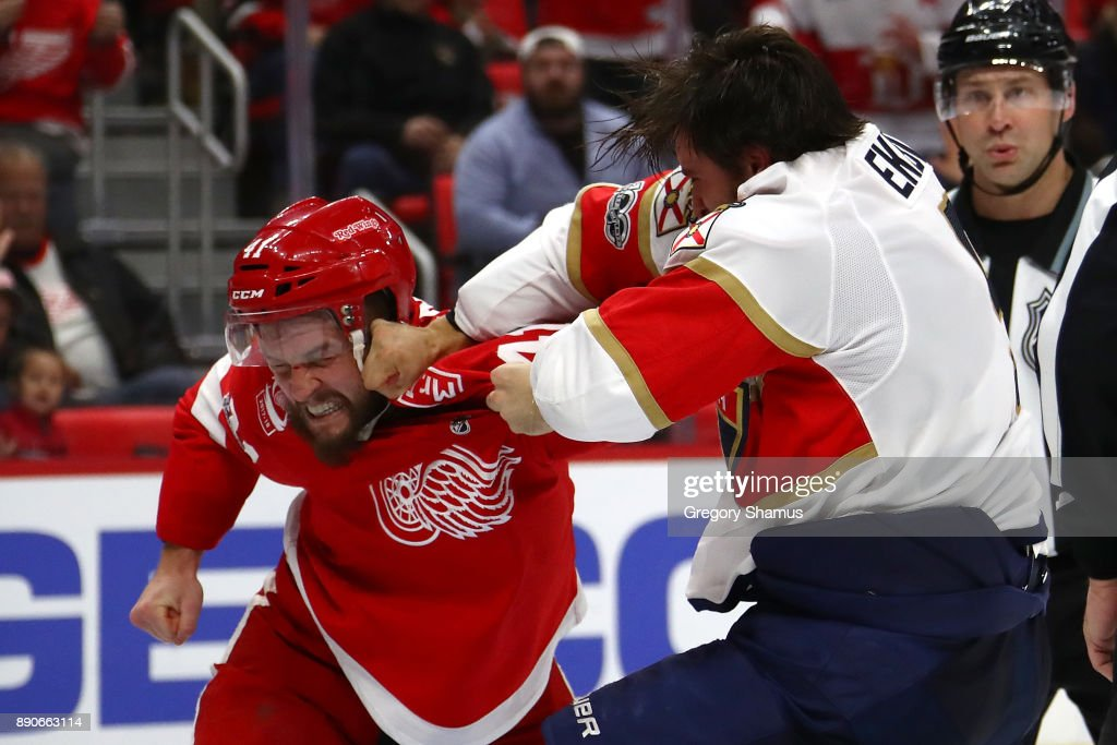 Luke Glendening #41 of the Detroit Red Wings fights Aaron Ekblad #5 of the Florida Panthers during the second period at Little Caesars Arena on December 11, 2017 in Detroit, Michigan.