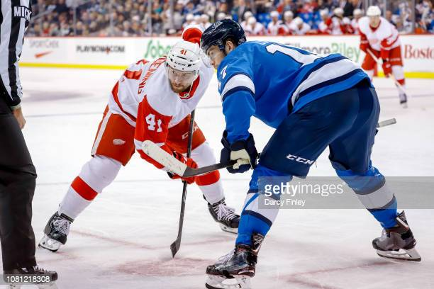 Luke Glendening of the Detroit Red Wings gets set for a third period faceoff against Adam Lowry of the Winnipeg Jets at the Bell MTS Place on January...