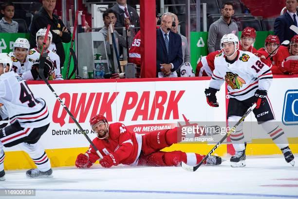 Luke Glendening of the Detroit Red Wings scores an open net goal against the Chicago Blackhawks during a pre-season NHL game at Little Caesars Arena...