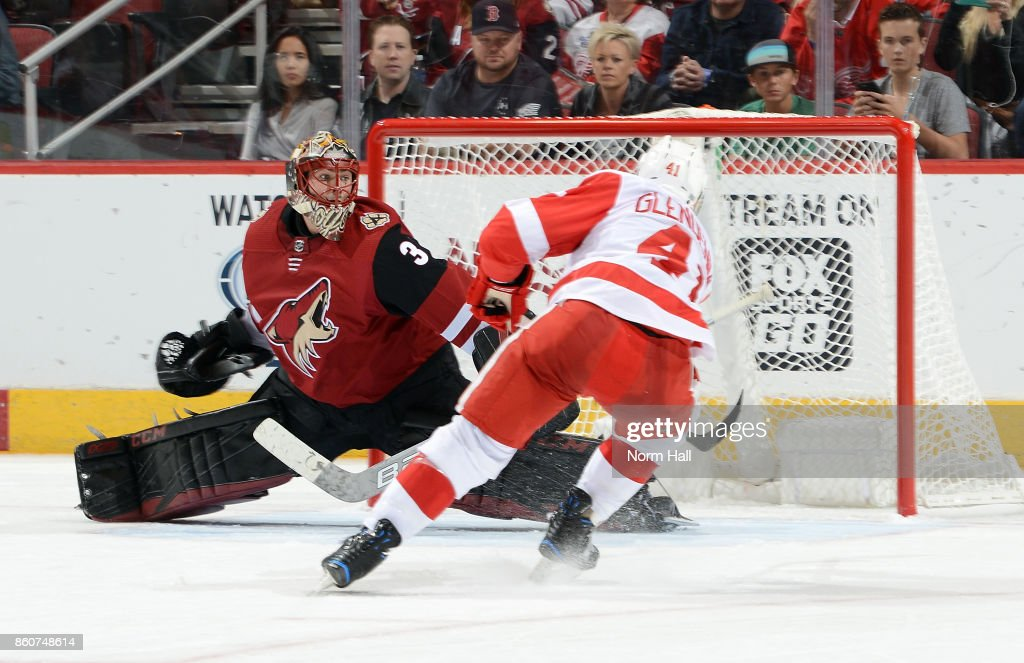 Luke Glendening #41 of the Detroit Red Wings shoots the puck past goalie Louis Domingue #35 of the Arizona Coyotes for a third period goal at Gila River Arena on October 12, 2017 in Glendale, Arizona. The Red Wings defeated the Coyotes 4-2.